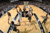 Milwaukee Bucks v San Antonio Spurs: Tony Parker and Ersan Ilyasova