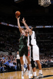 Milwaukee Bucks v San Antonio Spurs: Andrew Bogut and Tim Duncan