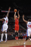 Toronto Raptors v Detroit Pistons: Linas Kleiza  Ben Wallace and Greg Monroe