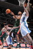 Milwaukee Bucks v Denver Nuggets: Corey Maggette and Chris Andersen