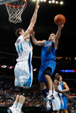 Dallas Mavericks v New Orleans Hornets: Jose Barea and Jason Smith