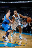 Dallas Mavericks v New Orleans Hornets: Jerryd Bayless and Jose Barea