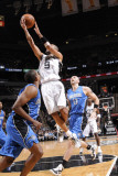 Orlando Magic v San Antonio Spurs: Tony Parker  Michael Piertrus and Marcin Gortat