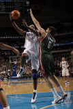 Milwaukee Bucks v Dallas Mavericks: Brendan Haywood and Andrew Bogut