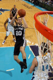 San Antonio Spurs v New Orleans Hornets: Manu Ginobili and Jason Smith