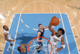 Minnesota Timberwolves v Denver Nuggets: Nene and Kevin Love
