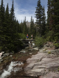Two Hikers Cross a Small Stream in the Montana Backcountry