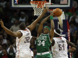 Boston Celtics v Charlotte Bobcats: Paul Pierce  Boris Diaw and Kwame Brown
