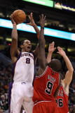Chicago Bulls v Phoenix Suns: Channing Frye and Luol Deng