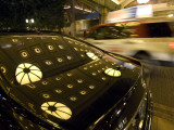 A Display of Lights Reflected on a Car