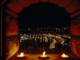 A Night View of Monaco over a Ledge with Candles