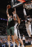 Milwaukee Bucks v San Antonio Spurs: Andrew Bogut and Tiago Splitter