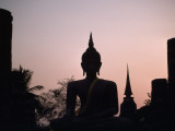 A Silhouette of a Buddha Statue at Sunset