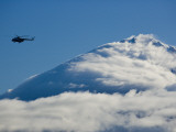 Tourists Fly over a Cloud-Covered Peak in Kronotsky Nature Reserve