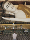 A Man Prays before the Reclining Shwethalyaung Buddha Statue