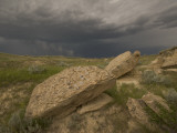 Thunderclouds Gather Above Eroded Buttes in the Grasslands