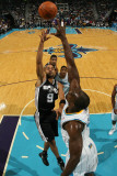San Antonio Spurs v New Orleans Hornets: Tony Parker and Emeka Okafor