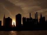 The Silhouetted Manhattan Skyline Seen from across the East River