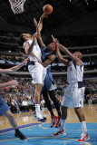 Minnesota Timberwolves v Dallas Mavericks: Corey Brewer  Tyson Chandler and Caron Butler