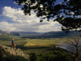 A Hiker Looks over the Teton Wilderness Area  Wyoming