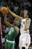 Boston Celtics v Charlotte Bobcats: Marquis Daniels and Shaun Livingston