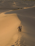 Teenagers Walk across Mesquite Dunes Near Stovepipe Wells