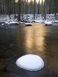 The Sun Reflects Off the River and Snow-Covered Rocks in Yosemite
