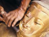 A Wood Carver Sculpts a Buddha Statue