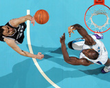 San Antonio Spurs v New Orleans Hornets: Manu Ginobili and Emeka Okafor