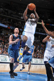 Minnesota Timberwolves v Denver Nuggets: Ty Lawson and Kevin Love