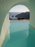 A Swimming Pool under an Arch Overlooking the Aegean Sea