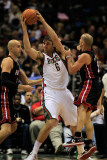 Miami Heat v Milwaukee Bucks: Andrew Bogut  Zydrunas Ilgauskas and Carlos Arroyo