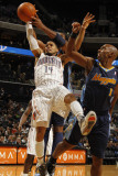 Denver Nuggets v Charlotte Bobcats: DJ Augustin and Nene