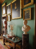 Framed Pictures and Sculpture Adorn a Green Room in Balfour Castle