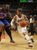 New York Knicks v Charlotte Bobcats: DJ Augustin and Ronny Turiaf