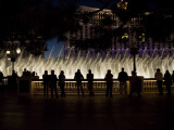 Tourists Watch a Lavish Display of Lights and Soaring Water