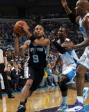 San Antonio Spurs v New Orleans Hornets: Tony Parker  Chris Paul and David West