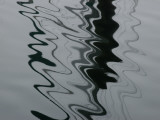 Abstract View of the Reflections of Pilings on Water