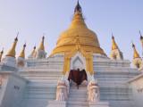 A Monk Runs Up the Steps of a Stupa