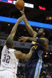 Denver Nuggets v Charlotte Bobcats: Nene and Boris Diaw