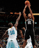 San Antonio Spurs v New Orleans Hornets: Tim Duncan and Emeka Okafor