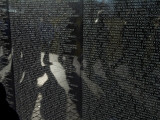 Shadows Reflected on the Wall of the Vietnam  Memorial