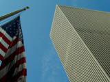 Skyward View of an American Flag in Front of a  Skyscraper