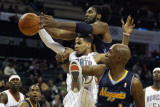 Denver Nuggets v Charlotte Bobcats: Nene  Chauncey Billups and DJ Augustin