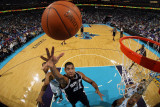 San Antonio Spurs v New Orleans Hornets: Tim Duncan and David West