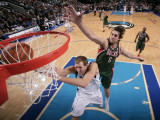 Milwaukee Bucks v Dallas Mavericks: Dirk Nowitzki and Andrew Bogut