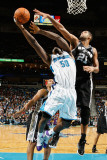 San Antonio Spurs v New Orleans Hornets: Emeka Okafor and Tim Duncan
