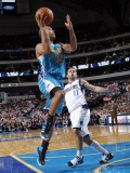 New Orleans Hornets v Dallas Mavericks: Jerryd Bayless and Jose Barea