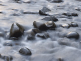 Water Rushing around Rocks in the Merced River in Yosemite Valley