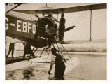 Alan Cobham Climbing into His Plane before Setting Off for Australia  Rochester  1926